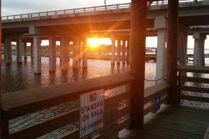Sunrise at St. Tammany Parish Fishing Pier located in Slidell, Louisiana on the north shore of Lake Pontchartrain. It is 650 feet long and connects with the I-10 Twinspans that were partially destroyed by Hurricane Katrina.